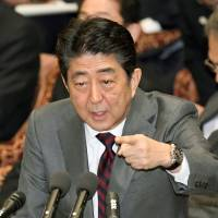 Abe moves to distance himself from Osaka school after praising principal's ideology