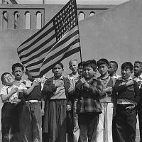 Japanese-American children pledge allegiance to the American flag in a photo taken on April 20, 1942, in San Francisco before their internment. | U.S. NATIONAL ARCHIVES