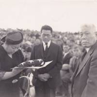 Suyekichi Kinoshita (right) and his wife Akino attend a ceremony at an internment camp in Idaho to commemorate their eldest son, Francis, who died in combat in Europe during World War II. | COURTESY OF TOM IKEDA