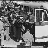 Japanese-Americans board buses on May 2, 1942, in Byron, California, in a photo taken by Dorothea Langue, who, while suffering from post-polio syndrome, tried to capture their mistreatment. | U.S. NATIONAL ARCHIVES