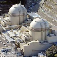 An aerial photo taken in January shows the No. 3 and 4 reactors at the Oi nuclear plant in Fukui Prefecture. | KYODO