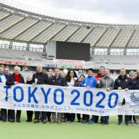 Representatives of various National Olympic Committees are given tours of 26 Olympic venues, including Ajinomoto Stadium in Tokyo on Monday. | PHOTO COURTESY OF TOKYO 2020 / UTA MUKUO / VIA KYODO