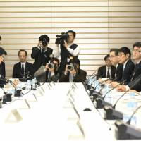 Japan panel proposes capping overtime at 720 hours a year