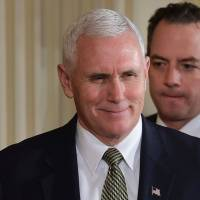 U.S. Vice President Mike Pence (left) and White House Chief of Staff Reince Priebus arrive for a joint press conference at the White House in Washington on Monday. | AFP-JIJI