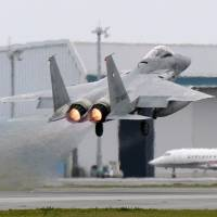 An F-15 fighter is scrambled from the Air Self-Defense Force's Naha base in Okinawa in April 2015. | KYODO