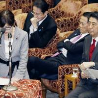 Defense Minister Tomomi Inada speaks during a Diet session on Tuesday, as Prime Minister Shinzo Abe watches. | KYODO