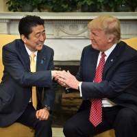 Trump welcomes Abe with warm White House embrace