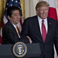 Despite the seemingly cozy ties Prime Minister Shinzo Abe built with U.S. President Donald Trump this month, students aspiring to study in America are having second thoughts about their plans. | BLOOMBERG