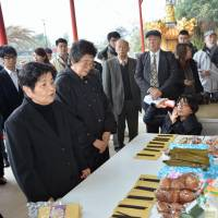 A group of Okinawans arrive in Keelung, Taiwan, on Tuesday to honor family members killed in the so-called '228 Incident,' a military crackdown on civilian protesters in 1947. | KYODO