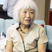 Momoko Williams, head of the Wasurena-gusa (Forget-Me-Not) Project, is interviewed in September in London. | KYODO