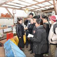 A Cambodian delegation inspects a waste station in the town of Kamikatsu, Tokushima Prefecture, in December. | KYODO