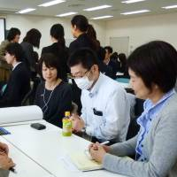 Company personnel managers gather in Tokyo last November to discuss issues related to employee relocations. | KYODO