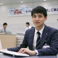 Zhang Yijun of China has been hired by Juroku Bank to work at one of its branches in Nagoya. | KYODO