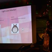 Anupreeta More, a postdoctoral researcher in astronomy at the University of Tokyo's Kavli Institute for the Physics and Mathematics of the Universe, uses Totoro to help explain light and matter in her talk about gravitational lensing. | SHANNON SCHUBERT