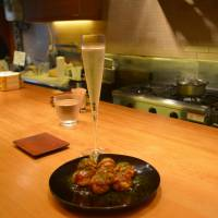 High and low: <em>Takoyaki</em> and champagne go well together. | J.J. O'DONOGHUE