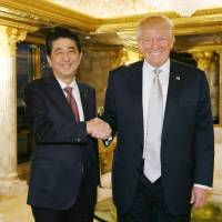 First impressions: Prime Minister Shinzo Abe meets U.S. President-elect Donald Trump in New York on Nov. 17. | KYODO