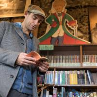 French connections: Librairie Omeisha's shelves are filled with all manner of French-language fiction and magazines. | BENJAMIN PARKS