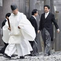 Divided loyalties: Prime Minister Shinzo Abe visits the Grand Shrines of Ise in Mie Prefecture on Jan. 4. | KYODO