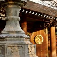 Coming back home: A lantern stands on the grounds of Yasukuni Shrine in Tokyo, a Shinto site dedicated to the nation's war dead.   ISTOCK
