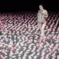 Key steps: A woman clothed in an accordion picks her way through silk carnations in 'Nelken.' | JOCHEN VIEHOFF
