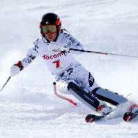 Emi Hasegawa competes during the women's slalom competition at the Asian Winter Games on Saturday in Sapporo. | AP