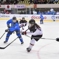Japan's Ami Nakamura makes a third-period pass during Saturday's game against Kazakhstan in the Asian Winter Games in Sapporo. Japan won 6-0. | KYODO