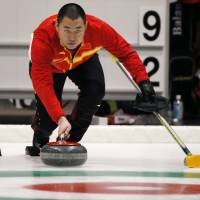 China outshines Japan in men's curling final