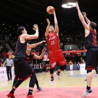 Diamond Dolphins guard Takaya Sasayama puts up a jumper in the lane during Sunday's game against the Alvark at Yoyogi National Gymnasium No. 2. Nagoya defeated Tokyo 81-77 in overtime.   B. LEAGUE