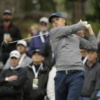 Spieth fires 65 to take lead