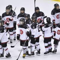 The Japan women's hockey team celebrates its 6-1 victory over China in the gold-medal match at the Asian Winter Games on Saturday in Sapporo. | KYODO