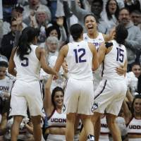 UConn women win 100th straight game
