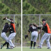 A sequence of pictures shows the Marlins' Ichiro Suzuki (left) colliding with Brandon Barnes during a drill in the outfield on Tuesday. | KYODO