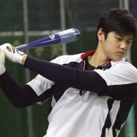Japan superstar Shohei Otani has been bothered by a persistent ankle ailment that will keep him off the mound at next month's World Baseball Classic. | AP