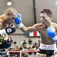 Tatsuya Fukuhara lands a punch on Mexico's Moises Calleros during their bout in Kamiakusa, Kumamoto Prefecture, on Sunday. | KYODO