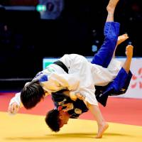 Uta Abe (left) throws Amandine Buchard for a wazari in the women's 52-kg final on Friday in Dusseldorf, Germany. The 16-year-old Abe became the youngest judoka in history to win a Grand Prix title. | KYODO