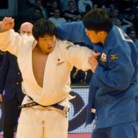 Kokoro Kageura (left) and Hisayoshi Harasawa compete in the men's 100-kg final at the Dusseldorf Grand Prix on Sunday.   KYODO
