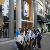 Mie Kajikawa (rear, second from left) poses with members of the Next Big Pivot training program in front of the NBA Store in New York during September of 2016. | NEXT BIG PIVOT
