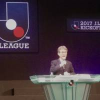 Hitoshi Sato, the manager for the J. League's stadium development group, makes a presentation during Monday's media day in Tokyo. | KAZ NAGATSUKA