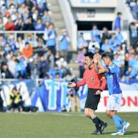 Kazuyoshi Miura applauds the crowd after being substituted in the 65th minute of Yokohama FC's 1-0 win over Matsumoto Yamaga in the J. League second division on Sunday. | KYODO