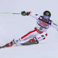 Austria's Marcel Hirscher competes during the men's giant slalom event at the world championships on Friday in St. Moritz, Switzerland. | AP