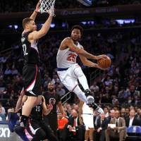 Clippers prevail over Knicks; Oakley arrested after scuffle