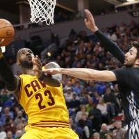 LeBron leads Love-less Cavs to win