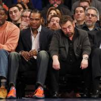 Knicks executive chairman James Dolan (second from right), seen with ex-Knicks Larry Johnson (left), Latrell Sprewell (second from left) and Bernard King during Sunday's game against the Spurs, faced a public backlash over his row with another ex-Knick, Charles Oakley. | USA TODAY / VIA REUTERS