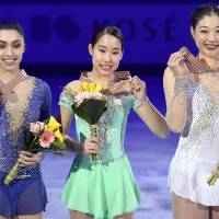 Winner Mai Mihara (center), silver medalist  Gabrielle Daleman of Canada (left) and third-place finisher Mirai Nagasu of the United States display their medals at the Four Continents Championships in Gangneung, South Korea, on Saturday night.   KYODO