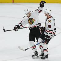 Toews lifts Blackhawks to OT triumph over Wild