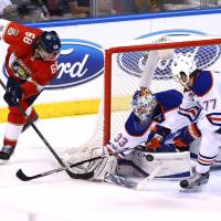 Oilers' McDavid, Russell team up to sink Panthers