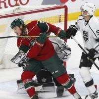 Wild strike quickly in OT to get past Kings