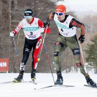 Akito Watabe (left) races against Bjoern Kircheisen of Germany during the 10-km cross-country portion of a World Cup individual Nordic combined event on Friday in Sapporo. Watabe finished second overall. | KYODO