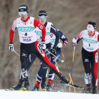Akito Watabe races in the 10-km cross country portion of a World Cup individual Nordic combined event on Saturday in Sapporo. Watabe placed first overall. | KYODO