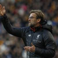 Liverpool out of title chase after recent run of poor form